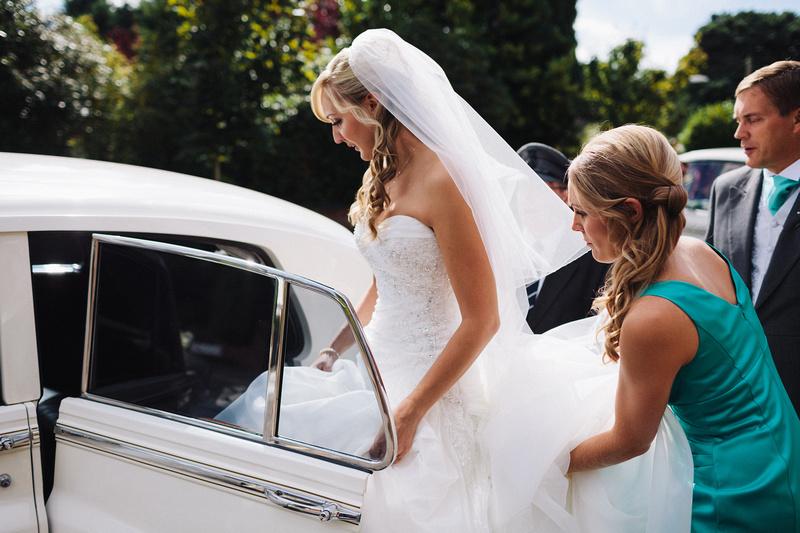 Bride going in the Cream Rolls Royce Wedding Car