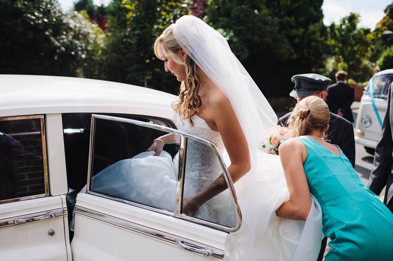 Nikki getting into the Rolls Royce for her Dorset Wedding
