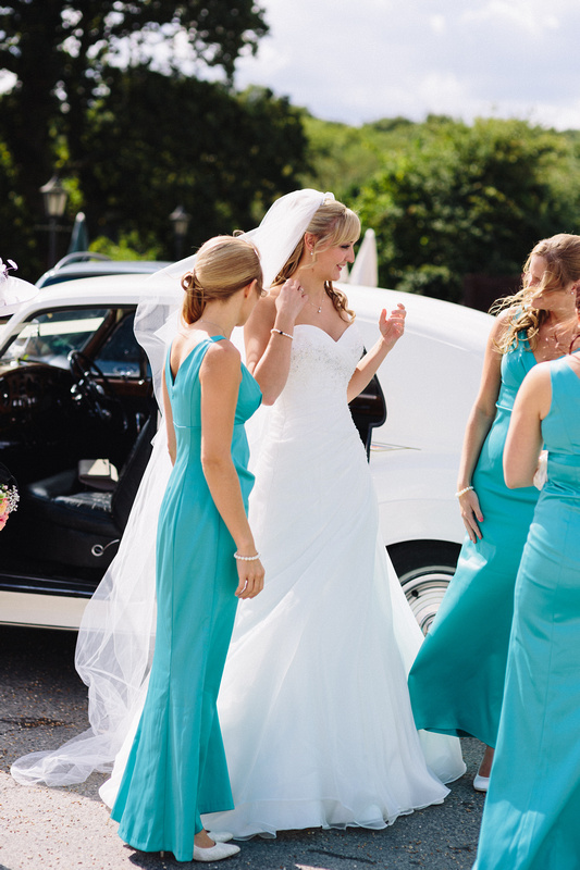 Bride with bridesmaids outside the Wedding Car