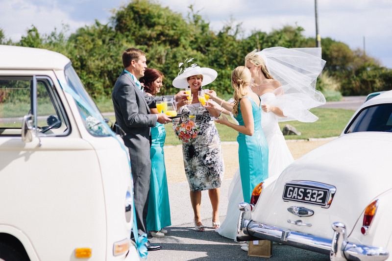 Bride and her Wedding Guest near the wedding cars