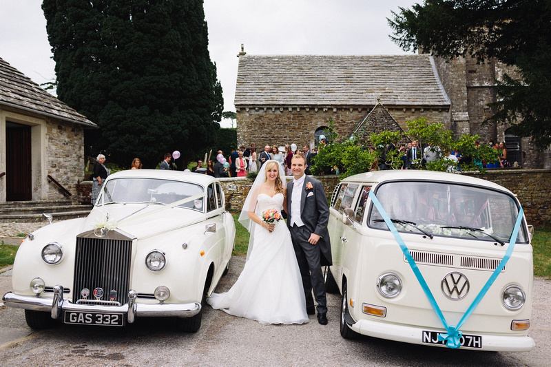 Happy couple with their wedding transport after the Wedding Ceremony