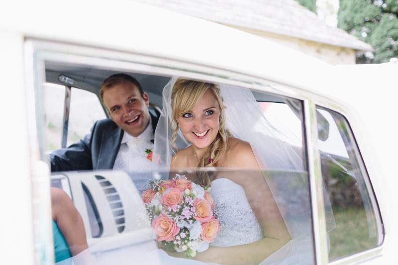 Bride and Groom in Rolls Royce Wedding Car