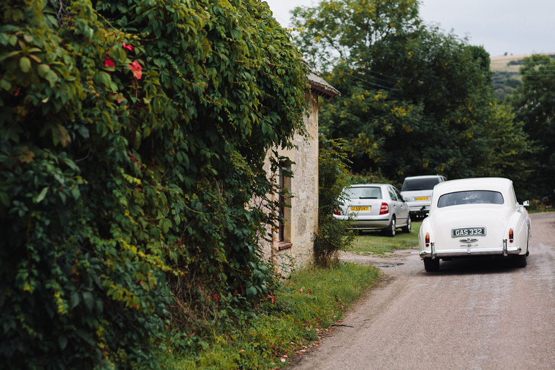 Classic Rolls Royce Wedding Car driving throughout Dorset's Countryside