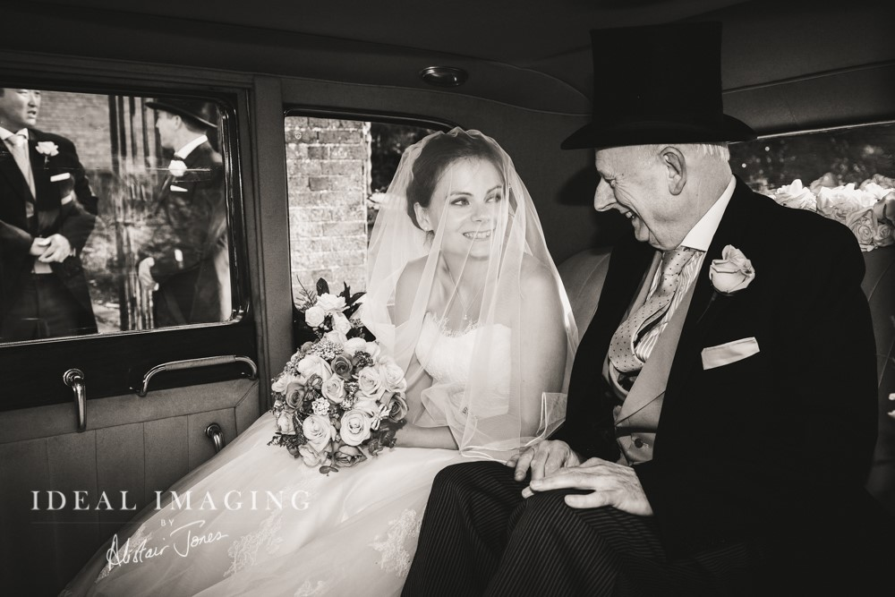 Bride and Bridesfather in Classic Rolls-Royce
