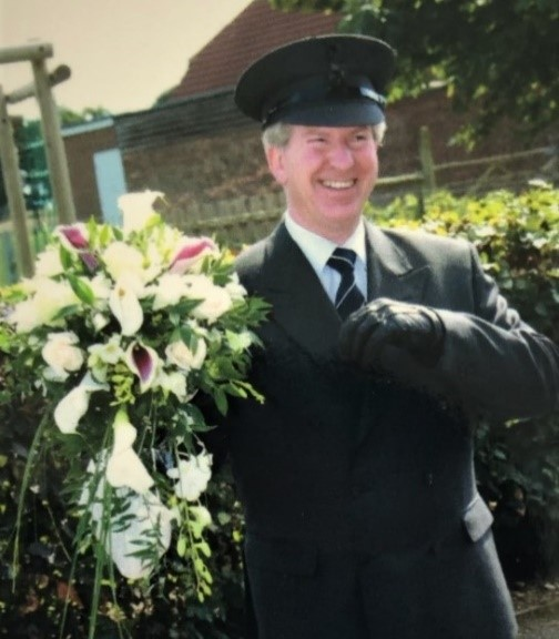 Picture of Michael Keene, Founder of Premier Carriage Wedding cars in his chauffeur's uniform